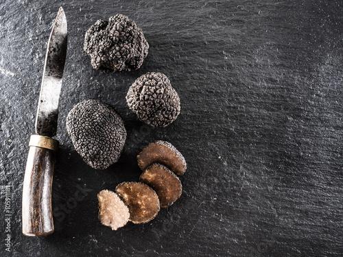 Black truffles on the graphite board.