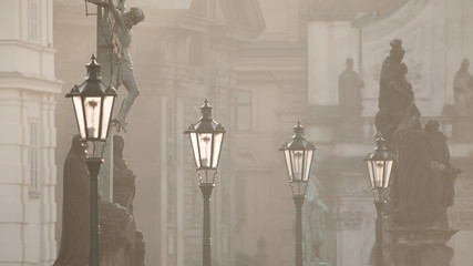 Obraz na Plexi Latarnie Street lamps on Charles bridge in the morning Prague