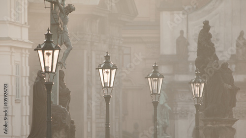 Street lamps on Charles bridge in the morning Prague - 105926781