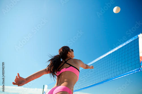 young woman with ball playing volleyball on beach Canvas-taulu