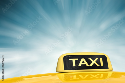 Fotografie, Obraz  taxi sign on blue abstract background