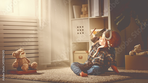 Tela concept of dreams and travels.  pilot aviator child with a toy a