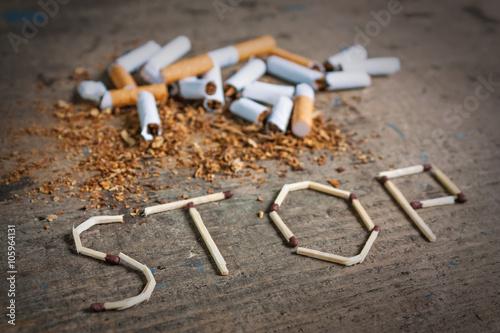 Cuadros en Lienzo Stop smoking background with broken cigarettes
