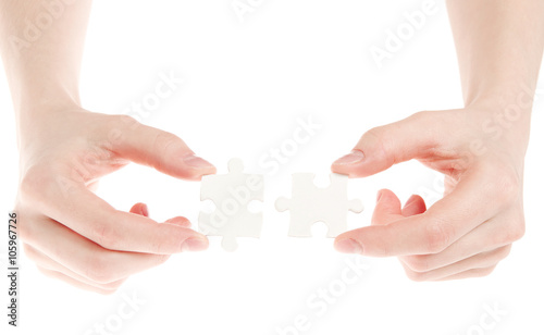 Fototapety, obrazy: puzzle in hand isolated on white background