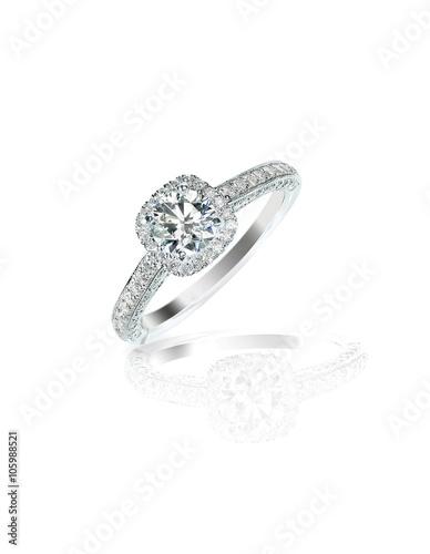 Fotografie, Obraz  Diamond solitaire engagement wedding ring isolated on white