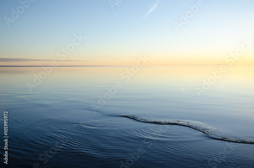 Smooth water and colorful sky