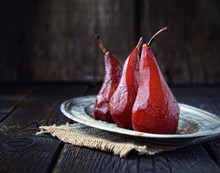 Pears In Red Wine On A Vintage...