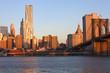 Beautiful view of the Brooklyn Bridge and Lower Manhattan at Sun