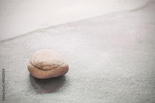 Foto op Plexiglas Stenen in het Zand Retro toned stone on a slate, natural background with copy space