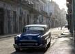 A classic blue car in the street of Havana