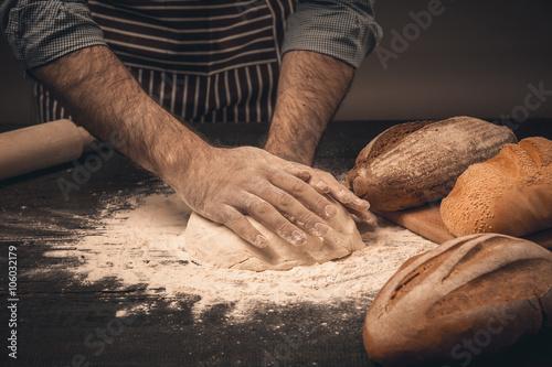 Aluminium Prints Bestsellers Male hands knead the dough.
