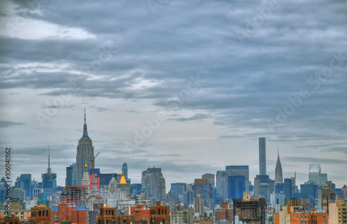 Artistic colorful HDR image of the skyline of Midtown Manhattan, New York City during sunset on a cloudy day - 106040162