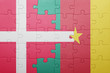 canvas print picture - puzzle with the national flag of denmark and cameroon