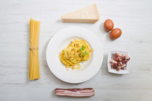 Flat Dish With Carbonara's Spaghetti And Ingredients
