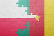 canvas print picture - puzzle with the national flag of poland and cameroon