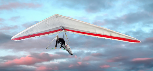 Fototapeta Man hang-gliding at sunset