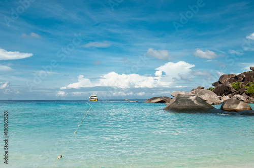 Fotobehang A scenic view on tropical beach with rocks, ocean, clouds and sky. Similan islands, Thailand, Phuket.