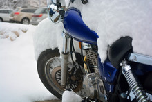 Snow Covered Motorcycle On A C...