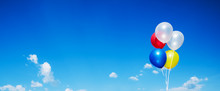 Colourful Balloon On Blue Sky With Tinny Clouds Background,Panoramic Cover Or Banner Background.