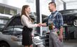 Customer woman and mechanic