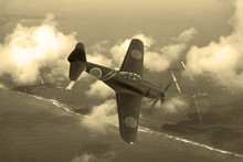 World War 2 Era Fighter Plane. Japnese Aricraft N1K-J Shiden Known As 'Geroge' By The Allies. Flying Over The Pacific Island Of Saipan. (Computer Image, Artist's Impression)
