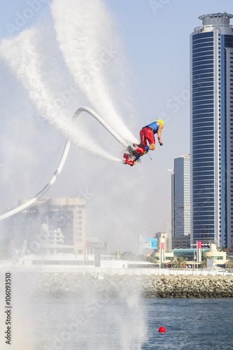 Poster Nautique motorise Extreme sportsman on flaybord performs tricks in the competitions in extreme sports in Dubai,UAE