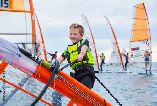 Foto  boy on windsurfing