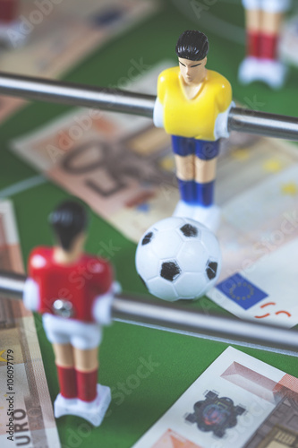 Sports and money  Concept about money spending in football (soccer
