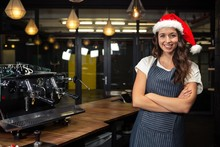Portrait Of Barista Wearing Santa Hat