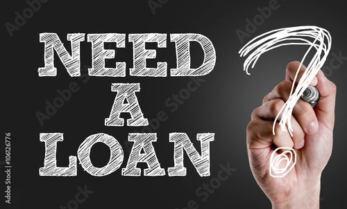Fotografía  Hand writing the text: Need a Loan?