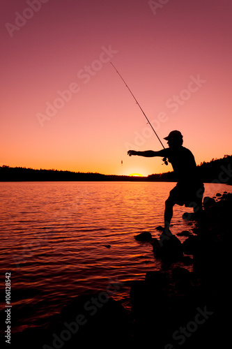 Foto op Canvas Vissen Fishing at Sunset