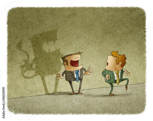 Fotografía  Man tiptoes while looking at colleague's evil shadow on wall
