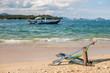 Beach lounge chair on sandy beach