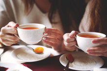 Womans With Cup Of Tea On Table In Cafe Or Restaurant
