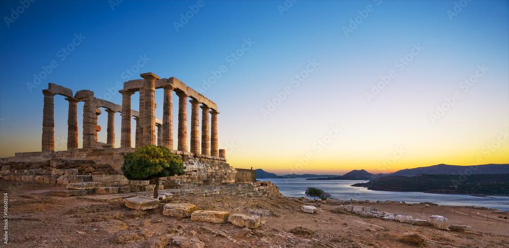 Fototapeta Greece. Cape Sounion - Ruins of an ancient Greek temple of Poseidon after sunset