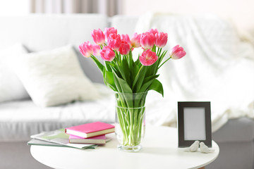 Fresh bouquet of tulips on a coffee table