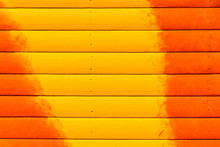 Section Of Orange And Yellow Panelling From A Beach Hut, Suitable For Backgrounds Of Beach, Seaside And Summer Holiday Themes.
