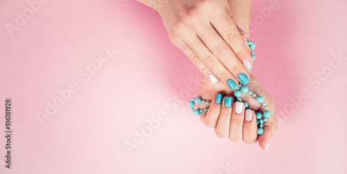 Fotografie, Obraz  beautiful manicure. gel polish coating in white and turquoise, s