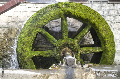 Photo  Old working mill wheel of watermill