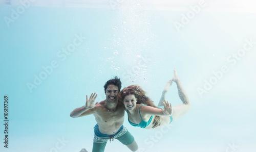Wall Murals Mermaid Smiling couple under water