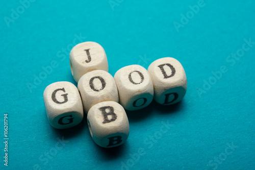 Fotografía  GOOD JOB text on a wooden cubes