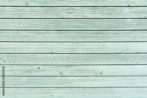 Fotografia Section of pale green wood panelling from a seaside beach hut