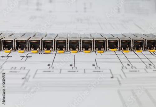 Vászonkép Electric gigabit sfp modules for network switch on the blueprint of  communicati