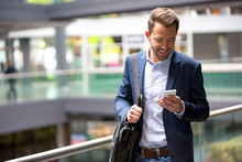 Young Attractive Business Man Using Smartphone