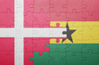 canvas print picture - puzzle with the national flag of ghana and denmark