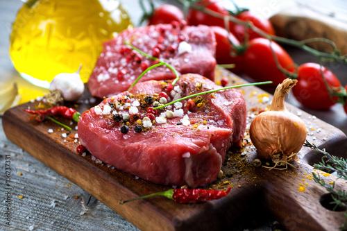 Fotografie, Tablou  Fresh raw beef steak on wooden background