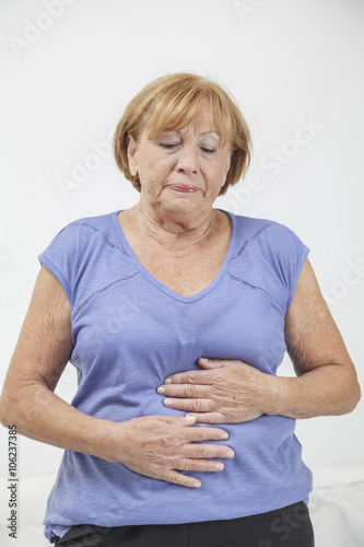 Αφίσα  Woman holding stomach
