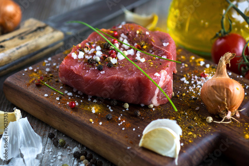 Fotografie, Tablou  Fresh raw beef steak on wooden background