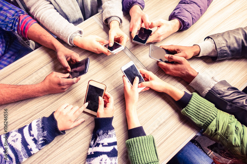Fotografie, Tablou  Top view hands circle using phone in cafe - Multiracial friends mobile addicted
