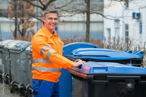 Working Man Standing Near Dustbin On Street